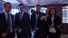 4K Aggressive business team prepare to go into battle with a variety of weapons Stock Footage