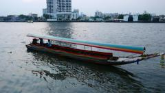 Long tail boat loudly departs and run away, Chao Phraya river in dusk Stock Footage