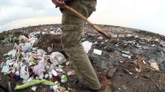 Man dump unemployed homeless dirty looking  food  waste in a landfill social Stock Footage