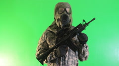 Soldier standing against the green screen. - stock footage
