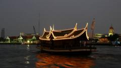 Surpass traditional wood ferry boat, decorated and by lit garland in night Stock Footage