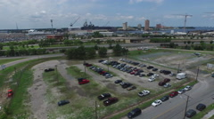 Norfolk, VA Parking lot and shipping in the background - stock footage
