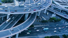 Time lapse: car running fast on a spiral bridge Stock Footage