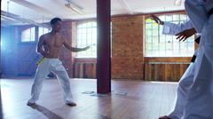 4K Outnumbered martial arts fighter skilfully uses nunchaku to beat opponents Stock Footage