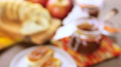 Homemade apple butter and freshly baked bread on the table. Stock Footage