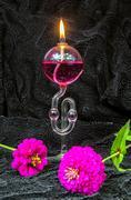 Kerosene lamp with fragrance on the black velvet Stock Photos