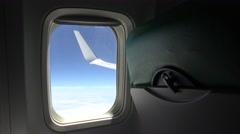 Wonderful view of the sky and clouds through an airplane window-Dan Stock Footage