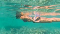 Free  diver swimming Stock Footage