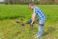 Technician calibrating multicopter compass pilot aviation - stock photo