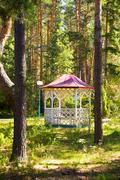 Comfortable arbour house in the park green forest Stock Photos