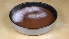 Powdering sugar powder on the chocolate cake Stock Footage