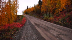 Primitive Gravel Road Leads on Autumn Fall Folaige Alaska Stock Footage