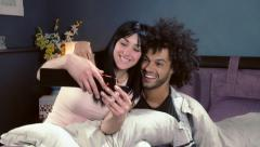 couple having fun selfie on the bed at home - stock footage