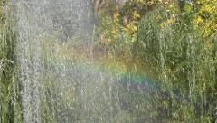 Rainbow from splash fountain Stock Footage