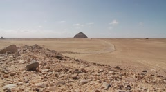 Bent pyramid of Dahshur built by Sneferu in distance, Egypt - stock footage