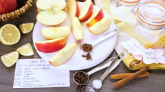 Ingredients for preparing homemade apple butter from organic apples. Stock Footage