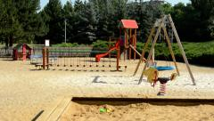 children playground with many equipment to the play in the suburbs - stock footage