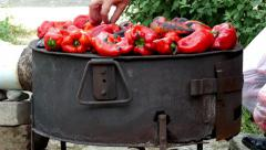 Roast peppers on furnace, 4K, woman preparing food for winter on traditional way Arkistovideo