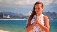 blonde girl in lace meditates in yoga asana standing - stock footage