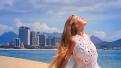 Stock Video Footage of blonde girl in lace shows yoga asana smiles against sea