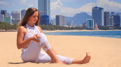 Stock Video Footage of blonde girl in lace shows yoga asana twisting