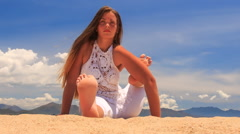 Stock Video Footage of girl in lace meditates in yoga asana left foot on arm