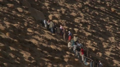 Tourists queue to enter Great Pyramid at Giza, Egypt - stock footage