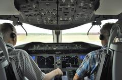 Pilots in the cockpit Boeing 787 Dreamliner Stock Photos