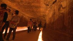 Abu Simbel ruins, Egypt, interior of temples with tourists, dutch tilt Stock Footage