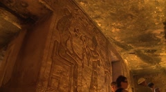 Abu Simbel ruins, Egypt, interior of temples with tourists, low angle, handheld Stock Footage