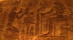 Abu Simbel temples, Egypt, interior of ruins with tourists, handheld, pan left Stock Footage