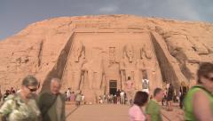 Abu Simbel temple, Egypt, exterior entrance with tourists in foreground Stock Footage