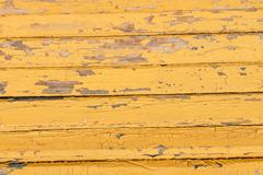 Stock Photo of Vintage wood background with peeling  yellow  paint