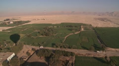 Aerial view over Nile River Valley, Egypt, cultivation agriculture & desert Stock Footage