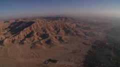 Aerial view from hot air balloon over desert in Nile River Valley, pan L-R Stock Footage