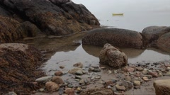 Static shot of a rocky tidal pool on the coast of Maine Stock Footage