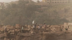 Archaeology workers excavate Egyptian archealogical dig at Aswan wide shot Stock Footage