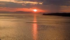 Epic Alaska Sunset Sunrise over the Ocean with Horizon Mountains - stock footage