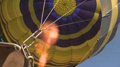 Hot air balloon gas burner ignites a flame to keep airborne Stock Footage