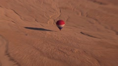 Stock Video Footage of Hot air balloon in Egypt, immediate zoom out to vast expanse of desert
