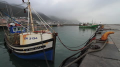 Cold Misty Harbour with Fishing Boats Stock Footage