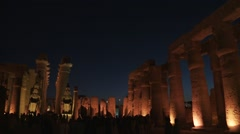 Karnak temple ancient Egyptian ruins at night in Luxor, Egypt - wide shot - stock footage