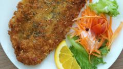 Video of Fried battered Fish and colourful salad Stock Footage