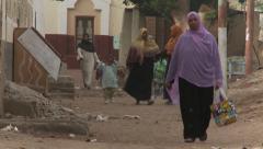 Nubian village life, Elephantine Island, Egypt, Africa - women & children walk Stock Footage