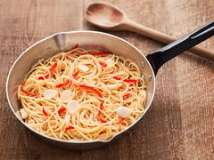 Rustic traditional italian aglio olio spaghetti pasta Stock Photos