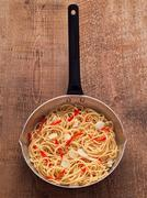 Rustic traditional italian aglio olio spaghetti pasta Stock Photos