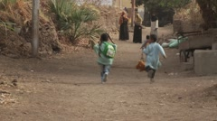 Stock Video Footage of Nubian villagers life on Elephantine Island, Egypt - schoolchildren run