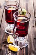 Mulled wine in the glasses, focus on the first glass - stock photo