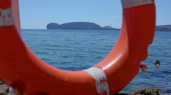 Coast Guard Lifebuoy Capo Caccia Bay Swim Area - 25FPS PAL Stock Footage