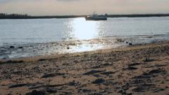 Boat crossing the horizon on the Walton Channel Stock Footage
